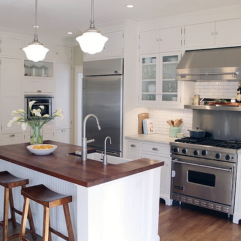 Beautiful Cottage Kitchen With Bright White Cabinets Paired With