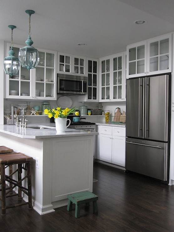Glass front upper cabinets transitional kitchen for Glass upper kitchen cabinets