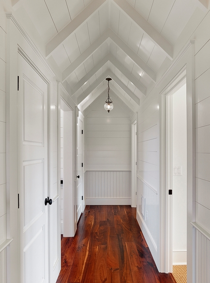 with glossy wood paneled walls and wood paneled cathedral ceiling