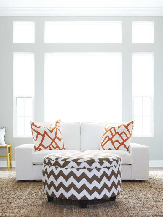 Contemporary living room with windows framing modern white slipcovered  two-cushion sofa filled with Schumacher Zimba Orange Pillows and white and  brown ... - White Slipcovered Sofa Design Ideas