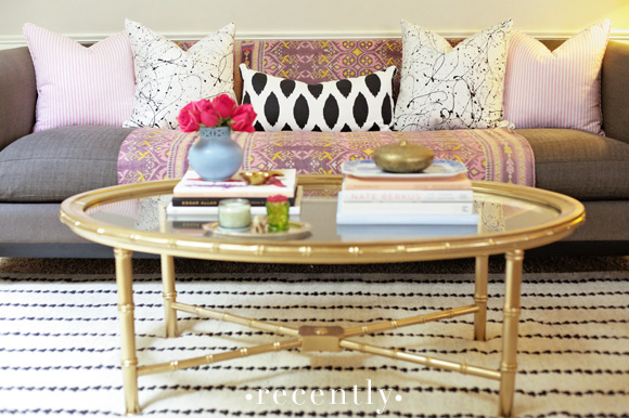 ... With Pink Pillows, Paint Splatter Pillows, Black And White Ikat Pillow  As Well As Pink And Purple Ethnic Throw Paired With Gold Bamboo Coffee Table  Over ...