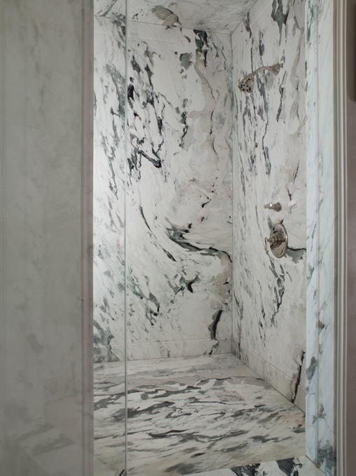 Breathtaking walk in shower with seamless marble walls  ceilings and  floors  The shower features a frameless glass shower door Gray And White Marble Design Ideas. Marble Walls For Shower. Home Design Ideas