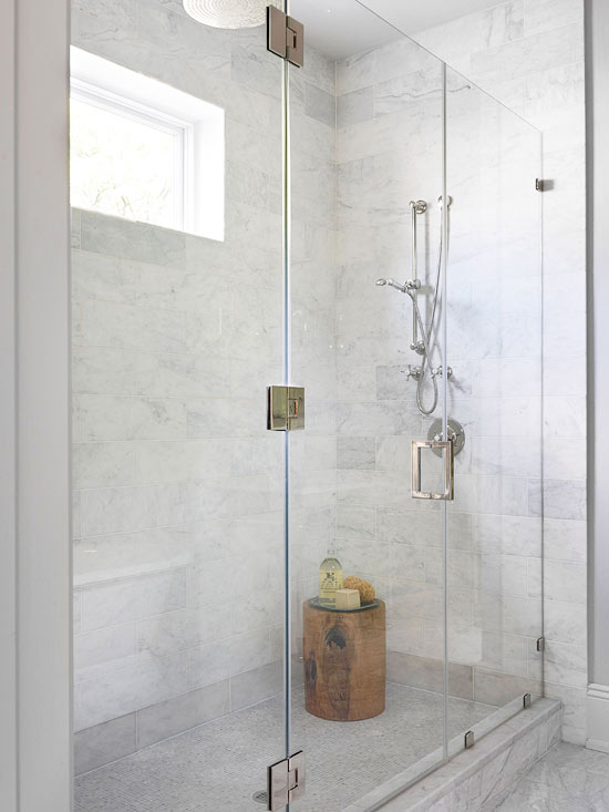glass shower enclosure with marble shower surround shower bench marble mosaic shower floor and teak stool