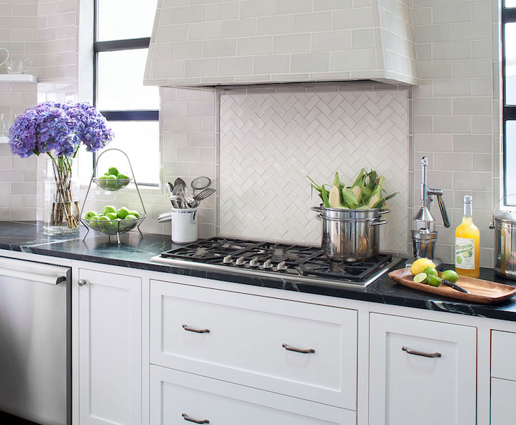 with soapstone countertops and light gray subway tile backsplash