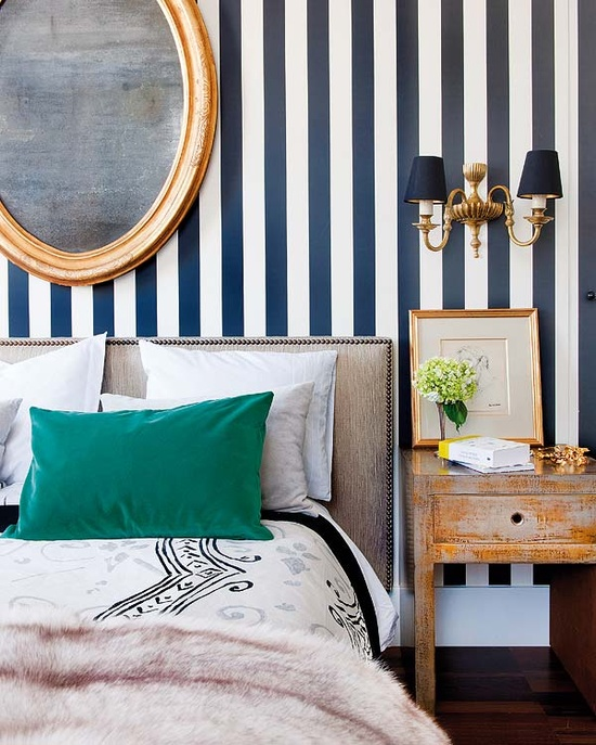 white and navy blue striped wall eclectic bedroom