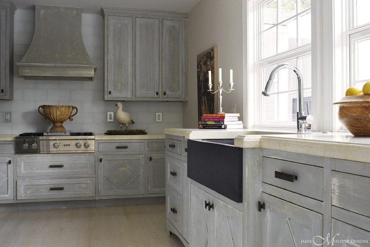 Beautiful distressed gray kitchen cabinets with oil-rubbed bronze hardware. - Distressed Gray Cabinets Design Ideas