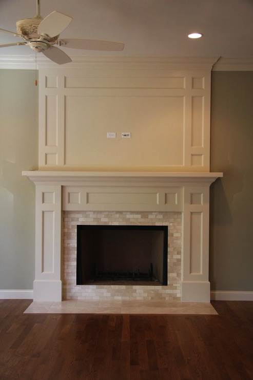 Stunning fireplace features cream fireplace millwork