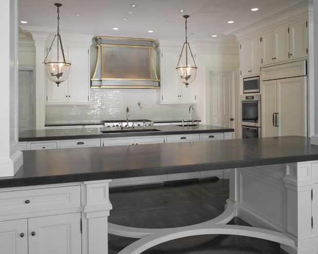 Stunning Kitchen Design With Open Pass Through And Matte Black Countertops.