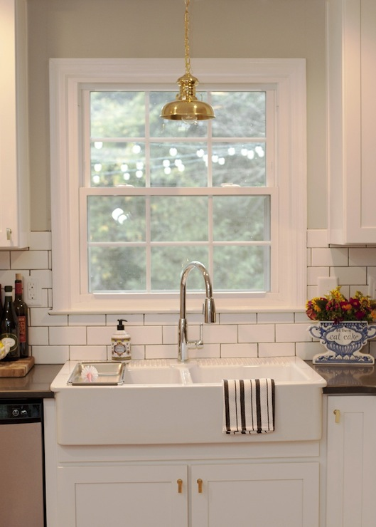kitchen features vintage brass light pendant double bowl sink modern faucet solid cabinet hardware polished clean