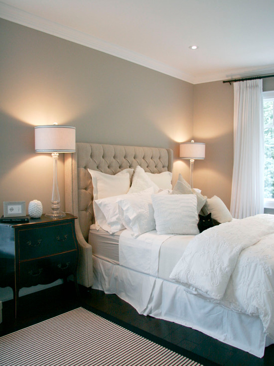 Gorgeous Bedroom Design With Beige Tufted Headboard With Nailhead Trim.