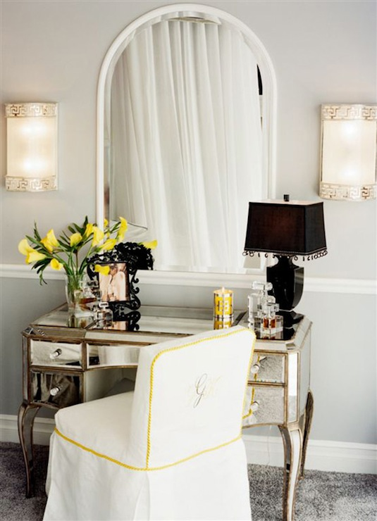 Pretty makeup area with Horchow Claudia Mirrored Vanity pairs with a white  slipcovered vanity chair with yellow piping and monogrammed detail. Mirrored Makeup Table with Gray Bench   Transitional   Bedroom