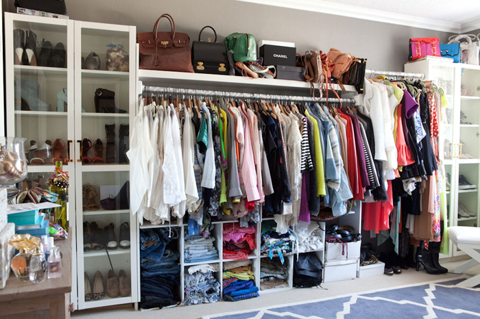 Fantastic Walk In Closet Design Featuring Ikea Billy Bookcase With Glass Doors Used To House Shoes Flanking Shelf For Designer Handbags Over Long Clothes