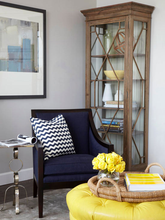 Yellow And Navy Blue Living Room With Navy Blue Chair Accented With White  And Navy Blue Chevron Pillow Paired With Chain Link Accent Table Over Gray  Rug.
