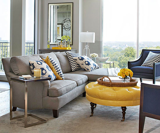 Yellow And Gray Living Room Featuring Sectional With Chaise Lounge Accented Blue Pillows Paired Mismatched End Tables Over Rug
