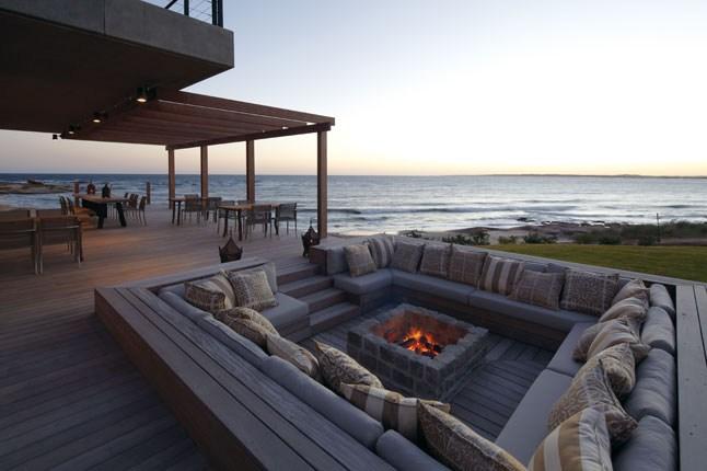 playa vik jose ignacio uruguay amazing outdoor pit featuring u shaped sectional and center stone fire pit