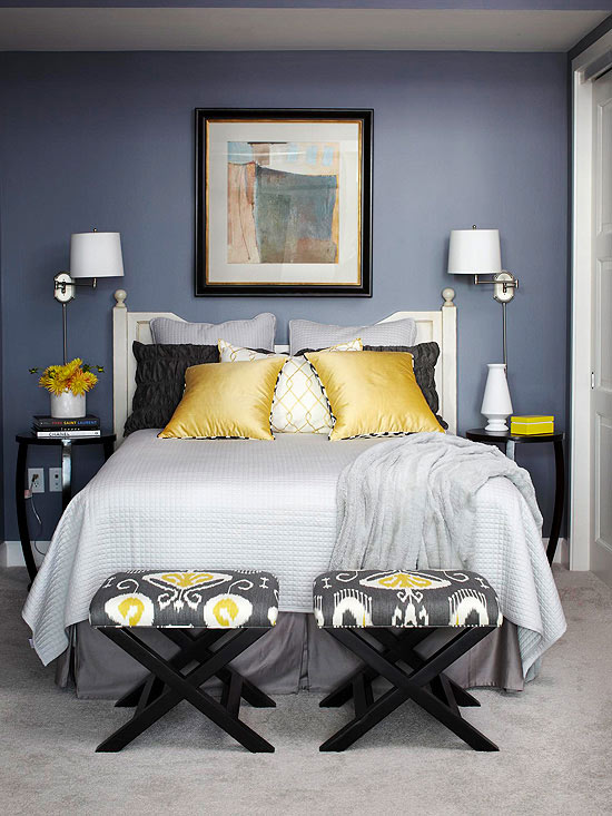 gray blanket gray bed skirt and yellow and black pillows layered over