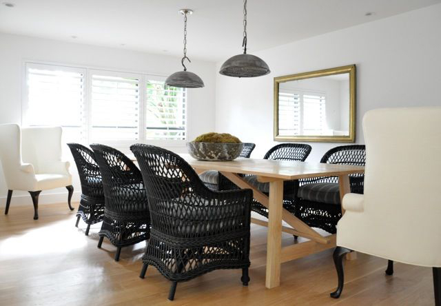 Modern Cottage Design With Galvanized Metal Light Pendants Over Light Wood  Rectangular Coffee Table Lined With Black Wicker Chairs As Well As Cream  Wingback ...