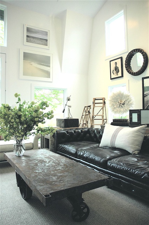 Black leather tufted sofa eclectic living room Black sofa decor