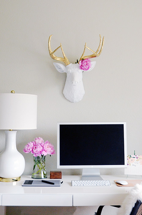 gorgeous styled desk with white faux taxidermy the alfred stag deer head white with gold antlers over lulu and georgia audrey lamp in white
