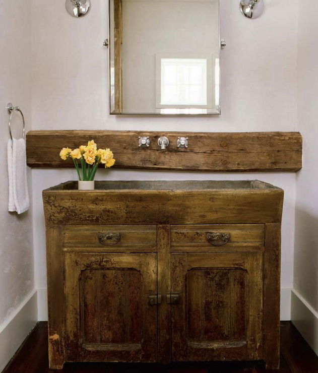 Rustic Country Bathroom With Sconces Flanking Rectangular Pivot Mirror