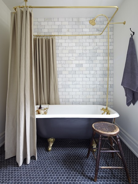Gorgeous Bathroom With Hexagonal Bluestone Marble Floor Tiles And Honed  Statuario Perla Marble Subway Tiled Accent Wall.