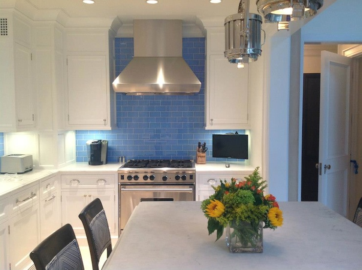 With Indigo Blue Subway Tile Backsplash And Honed Marble Countertop