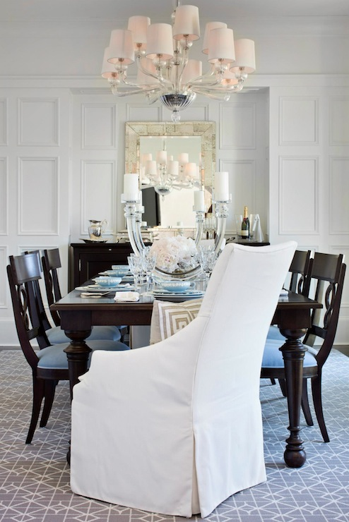 Sophisticated Dining Room With Full Wall Wainscoting Framing Antiqued Mirror Over Espresso Buffet
