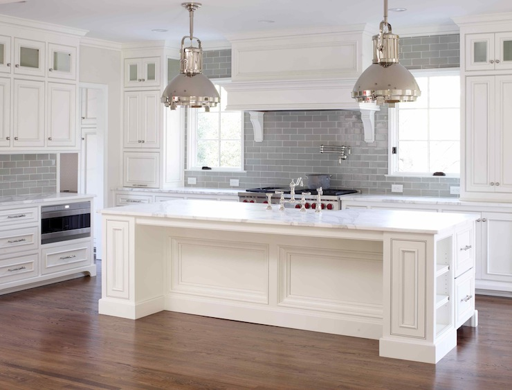 with calcutta gold marble countertops and gray subway tile backsplash