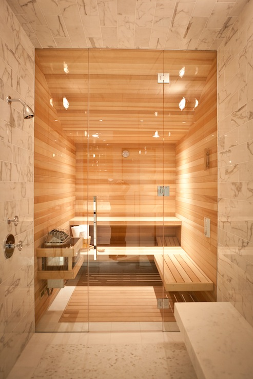 amazing home sauna room with teak surround as well as wraparound teak bench over teak floor