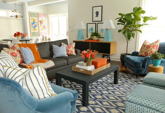 Black sofa with orange hermes blanket transitional for Blue and orange room