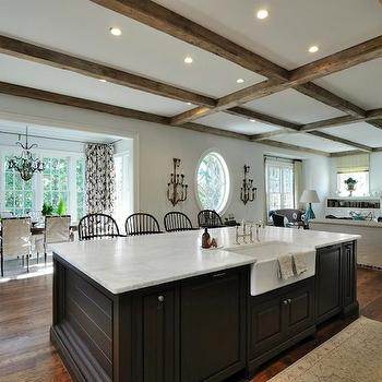 Kitchen With Dark Brown Kitchen Island With Marble Countertop And