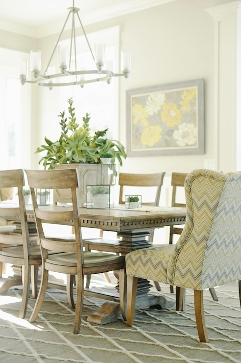 Yellow and gray chair transitional dining room for Grey and yellow dining room ideas