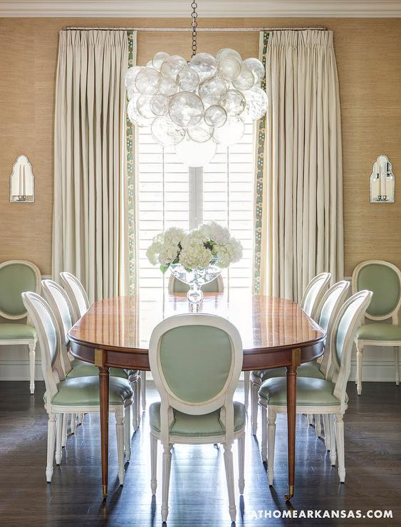 Pastel green dining chairs transitional dining room for Light green dining room