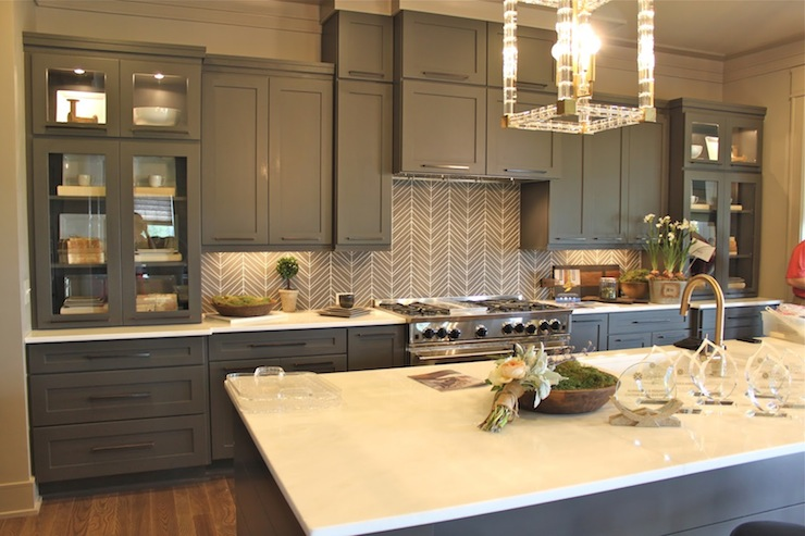 Gray kitchen with gray cabinets paired with white countertops and gray