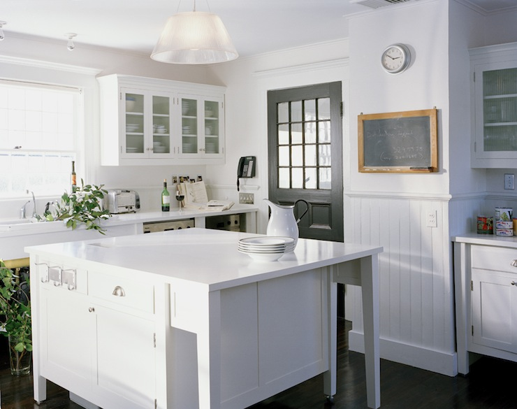 White cabinets with black countertops transitional for Black beadboard kitchen cabinets