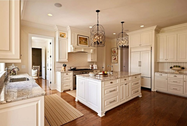 kitchen with ceiling height cabinetry painted Benjamin Moore's White