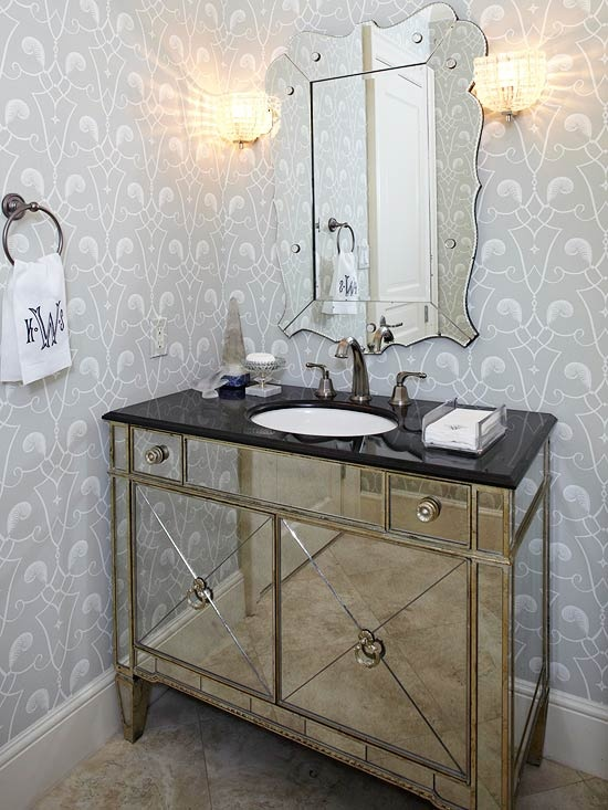 Gorgeous bathroom with gray and white patterned wallpaper and tiled floors.