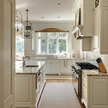 Stunning kitchen with cabinets painted in benjamin moore white dove