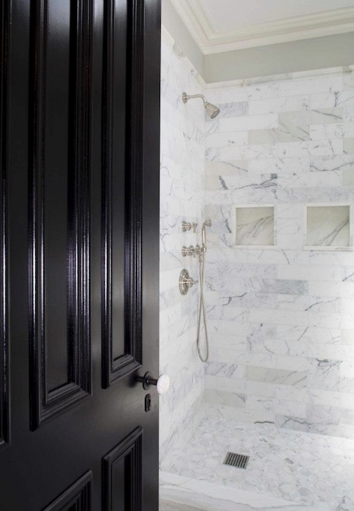 stunning bathroom with marble tiled walk in shower featuring recessed tiled cubbies and a satin nickel shower kit