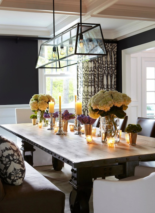 Gorgeous dining room features navy blue walls paired with for Navy dining room ideas