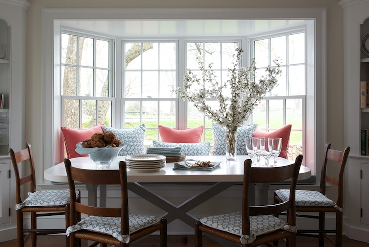 sweet dining room featuring built in bench filling bay window accented