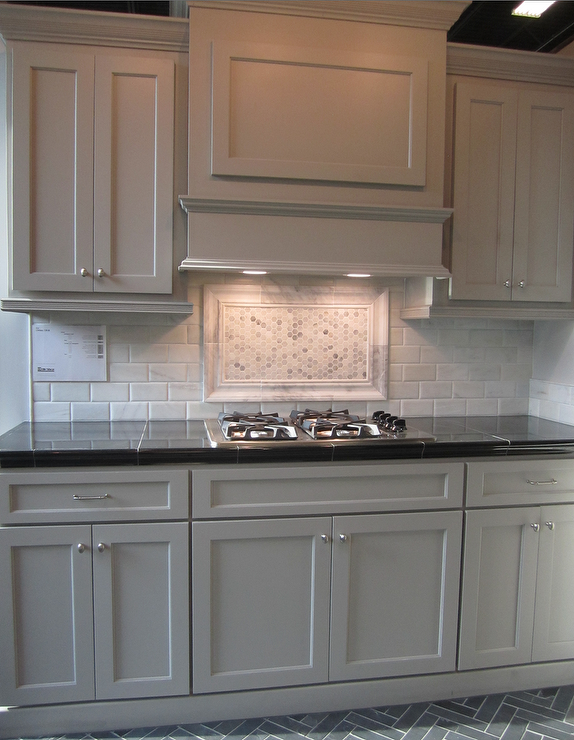gray kitchen cabinets marble backsplash slate herringbone floor