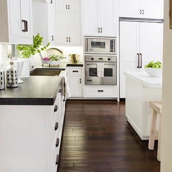 Cabinets Adorning Oil Rubbed Bronze Hardware And A Honed White Marble  Countertop.