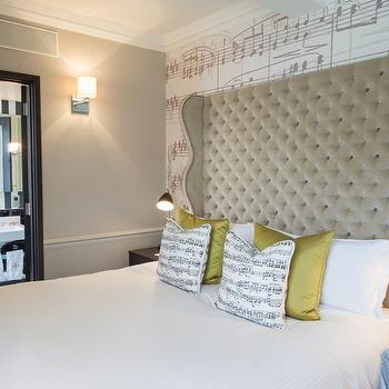 Tall Tufted Headboard view full size. Stunning bedroom features tall tufted  headboard on sheet music wallpaper ...