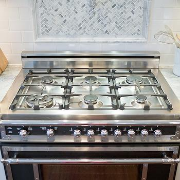 backsplash accented with swing arm pot filler over bertazzoni heritage