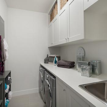 combo mudroom laundry room with white built in cabinetry paired with