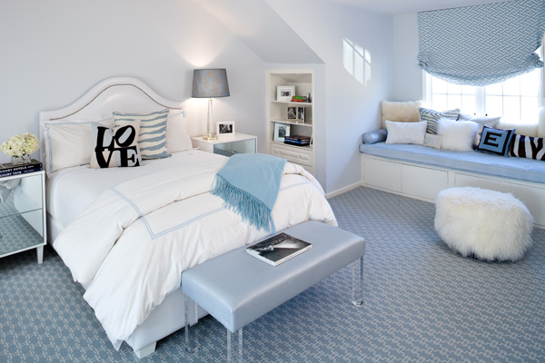 gorgeous blue bedroom with light blue walls and blue and white geometric patterned carpeting