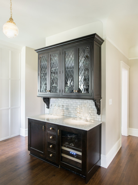 Leaded Glass Bar Cabinets With Black Granite Countertops