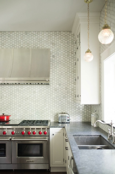 and ceiling height backsplash in hampton carrera marble hex tiles