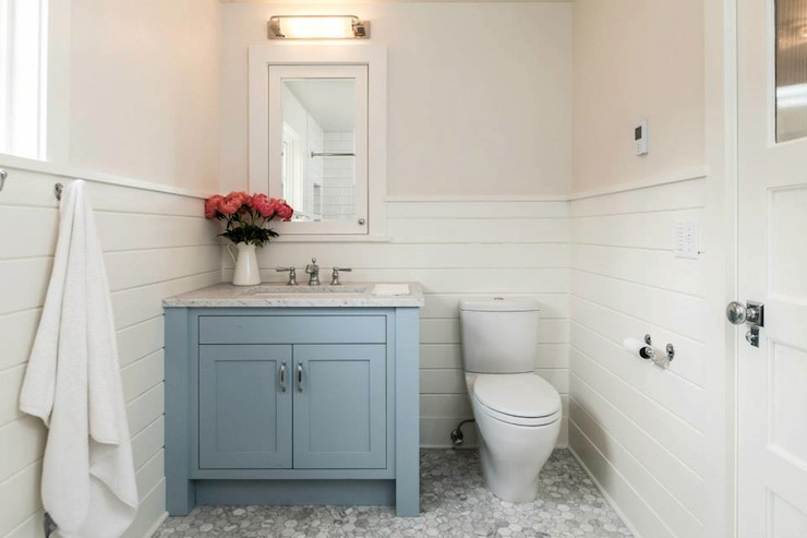 bathroom with off white walls paired with white tongue and groove